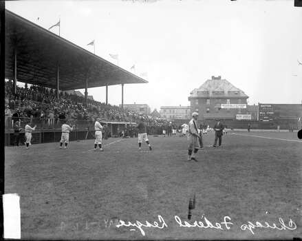 View of unidentified baseball players standing in front of grandstands on the field at Weeghman Park, located at 1060 West Addison Street, Chicago, Illinois, 1914. Weeghman Park was renamed Wrigley Field in 1927. (Photo by Chicago History Museum/Getty Images) Photo: Chicago History Museum, Getty Images