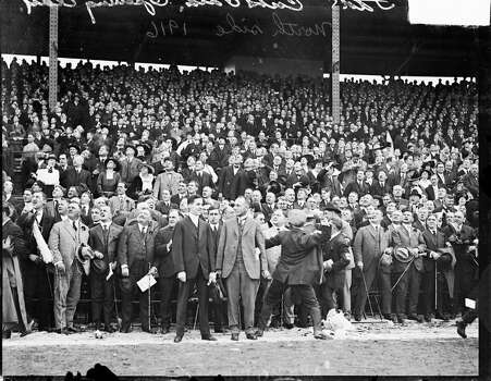 National League's Chicago Cubs baseball game spectators standing in the grandstands on opening day at Weeghman Park, Chicago, Illinois, 1916. Weeghman Park was renamed Wrigley Field in 1927. (Photo by Chicago History Museum/Getty Images) Photo: Chicago History Museum, Getty Images