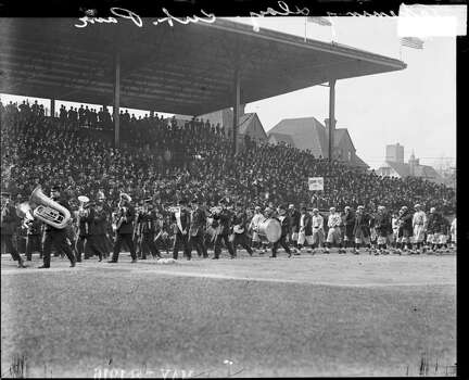 The Chicago Cubs follow a marching band at Weeghman Park on opening day, Chicago, Illinois, 1916. Weeghman Park was renamed Wrigley Field in 1927. (Photo by Chicago History Museum/Getty Images) Photo: Chicago History Museum, Getty Images