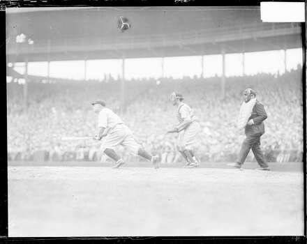 Chicago Cubs baseball player Hack Wilson running forward from home plate after hitting a baseball during a game at Wrigley Field, located at 1060 West Addison Street, Chicago, Illinois, 1929. An unidentified catcher and umpire are standing behind home plate. (Photo by Chicago History Museum/Getty Images) Photo: Chicago History Museum, Getty Images