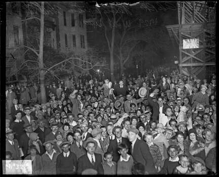 Night view of crowds standing outside Wrigley Field, waiting to enter the ballpark for a World Series game between the National League's Chicago Cubs and the American League's Philadelphia Athletics, Chicago, Illinois, 1929. (Photo by Chicago History Museum/Getty Images) Photo: Chicago History Museum, Getty Images