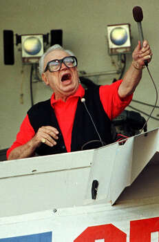 "Chicago Cubs baseball announcer and Baseball Hall of Fame inductee Harry Caray conducts fans singing ""Take Me Out to the Ball Game"" from his television booth during the seventh inning stretch in this August 1997 file photo at Wrigley Field,. Photo: VINCENT LAFORET, AFP/Getty Images / AFP"