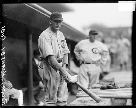 Chicago Cubs baseball player Rogers Hornsby holding a rosin bag on a baseball bat, standing in a dugout at Wrigley Field, Chicago, Illinois, 1929. (Photo by Chicago History Museum/Getty Images) Photo: Chicago History Museum, Getty Images