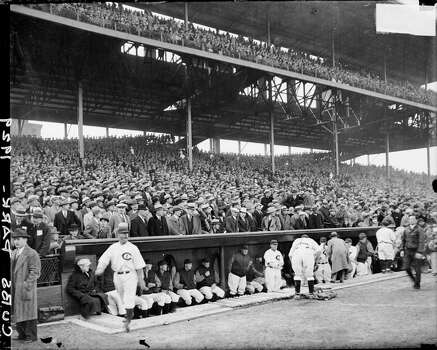 Chicago Cubs baseball players and managers in around the dugout in front of crowds in the grandstands at Wrigley Field, located at 1060 West Addison Street, Chicago, Illinois, 1929. (Photo by Chicago History Museum/Getty Images) Photo: Chicago History Museum, Getty Images
