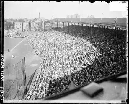 Crowds sitting and standing in the grandstands along the first baseline at Wrigley Field, located at 1060 West Addison Street, Chicago, Illinois, 1927. (Photo by Chicago History Museum/Getty Images) Photo: Chicago History Museum, Getty Images