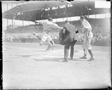 Unidentified Chicago Cubs baseball player leaping in the air towards home plate during a game at Wrigley Field, located at 1060 West Addison Street, Chicago, Illinois, 1929. (Photo by Chicago History Museum/Getty Images) Photo: Chicago History Museum, Getty Images