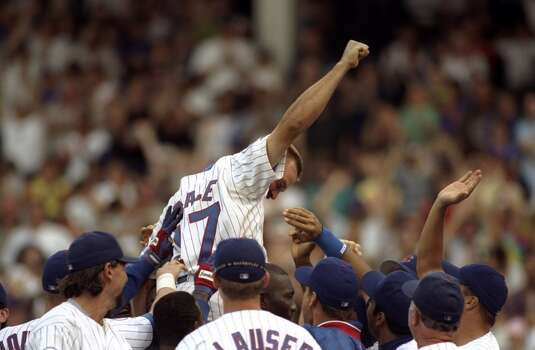 Pitcher Mark Grace #17 of the Chicago Cubs cheers as he is lifted by the team after a win against the Milwaukee Brewers at Wrigley Field in Chicago, Illinois. Photo: Jonathan Daniel, Getty Images
