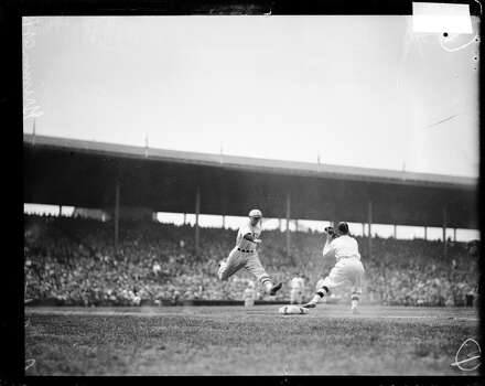 Unidentified baseball player of the New York Giants, leaping towards first base during a game against the Cubs at Wrigley Field, Chicago, Illinois, 1926. Cubs first baseman, Grimm, is standing at first base. (Photo by Chicago History Museum/Getty Images) Photo: Chicago History Museum, Getty Images