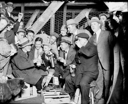 Group of men and a boy sitting on crates outside Wrigley Field, waiting to enter the ballpark for a World Series game between the National League's Chicago Cubs and the American League's Philadelphia Athletics, Chicago, Illinois, 1929. (Photo by Chicago History Museum/Getty Images) Photo: Chicago History Museum, Getty Images