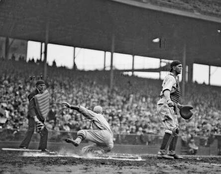 Unidentified New York Giants baseball player sliding into home plate during a game at Wrigley Field, Chicago, Illinois, 1928. An unidentified catcher of Chicago Cubs is standing in front of home plate. (Photo by Chicago History Museum/Getty Images) Photo: Chicago History Museum, Getty Images