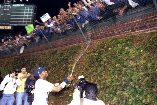 Right fielder Sammy Sosa #21 of the Chicago Cubs celebrates a victory over the San Francisco Giants by showering the fans with champagne following a game at Wrigley Field in Chicago, Illinois. The Cubs defeated the Giants 5-3. Mandatory Cred Photo: Jonathan Daniel, Getty Images