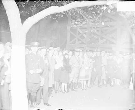 Crowd standing behind policemen at night outside Wrigley Field, waiting to enter the ballpark for a World Series game between the National League's Chicago Cubs and the American League's Philadelphia Athletics, Chicago, Illinois, 1929. (Photo by Chicago History Museum/Getty Images) Photo: Chicago History Museum, Getty Images