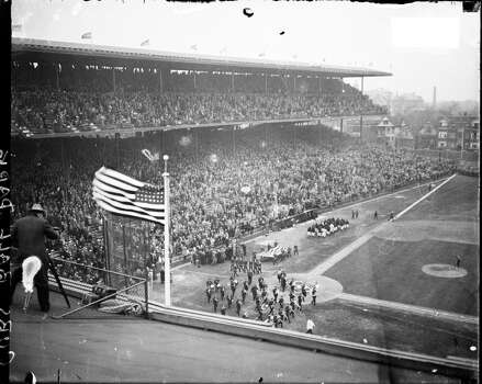 Elevated view of a marching band and people carrying a large American flag at Wrigley Field, located at 1060 West Addison Street, Chicago, Illinois, 1927. (Photo by Chicago History Museum/Getty Images) Photo: Chicago History Museum, Getty Images