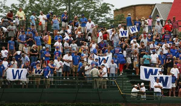 Chicago Cubs fans hold W (win) flags in the left field bleachers after a Cubs victory over the Houston Astros on August 6, 2008 at Wrigley Field in Chicago, Illinois. The Cubs defeated the Astros 11-4. (Photo by Jonathan Daniel/Getty Images) Photo: Jonathan Daniel, Getty Images