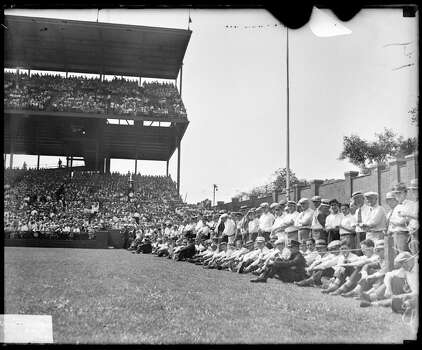 Spectators sitting and standing behind a rope barrier along the left field wall at Wrigley Field during a World Series game between the National League's Chicago Cubs and the American League's Philadelphia Athletics, Chicago, Illinois, 1929. Policemen are sitting amid the crowds. (Photo by Chicago History Museum/Getty Images) Photo: Chicago History Museum, Getty Images