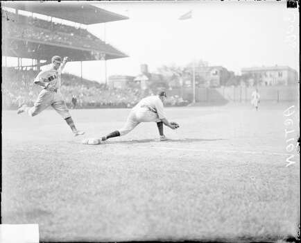 Unidentified Chicago Cubs baseball player lunging to catch ball at first base as unidentified Boston Braves baseball player reaches the base at Wrigley Field, Chicago, Illinois, 1929. (Photo by Chicago History Museum/Getty Images) Photo: Chicago History Museum, Getty Images