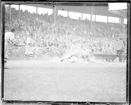 Unidentified Chicago Cubs baseball player sliding into home plate during a game at Wrigley Field, located at 1060 West Addison Street, Chicago, Illinois, 1926. (Photo by Chicago History Museum/Getty Images) Photo: Chicago History Museum, Getty Images