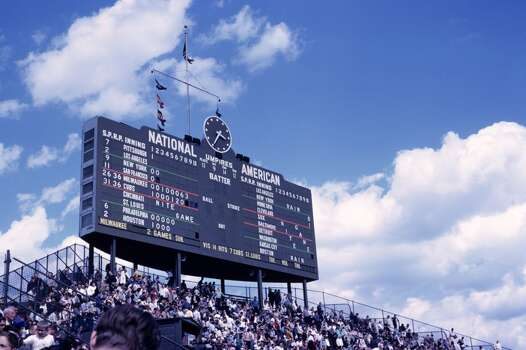 The scoreboard above the centerfield bleachers tells the score of the game as well as those from around the major leagues during a game on May 18, 1963 between the Milwaukee Braves and the Chicago Cubs at Wrigley Field in Chicago, Illinois. (Photo by: Diamond Images/Getty Images) Photo: Diamond Images, Diamond Images/Getty Images