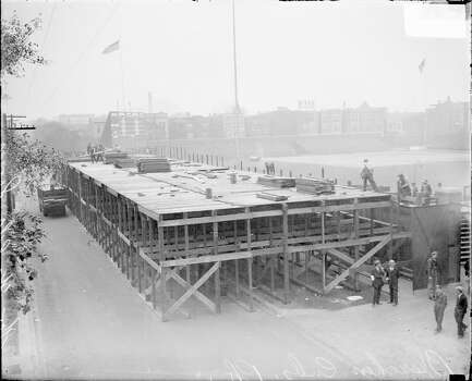 Men standing in front of and atop a raised platform for temporary stands outside the left field wall on West Waveland Avenue at Wrigley Field for a World Series game between the National League's Chicago Cubs and the American League's Philadelphia Athletics, Chicago, Illinois, 1929. (Photo by Chicago History Museum/Getty Images) Photo: Chicago History Museum, Getty Images