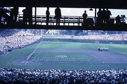 A general view of the field as members of the American League and National League teams line up along the baselines for the playing of the national anthem prior to the Major League Baseball All-Star Game on July 30, 1962 at Wrigley Field in Chicago, Illinois. 62-714348 (Photo by:  Diamond Images/Getty Images) Photo: Diamond Images, Diamond Images/Getty Images