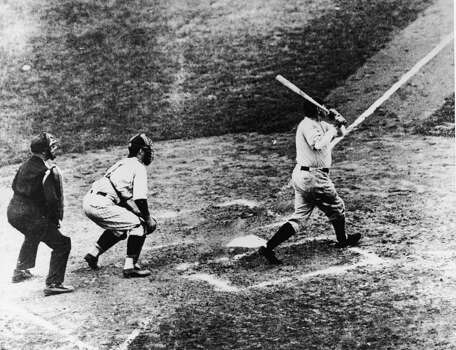 Legendary American baseball player Babe Ruth (1895 - 1948) of the New York Yankees hits a home run in the third game of the World Series against the Chicago Cubs at Wrigley Field, Chicago, October 1, 1932. It was during this game that Ruth gestured with his bat before hitting a home run giving birth to the legend of the 'Called Shot.' (Photo by  B. Bennett/Getty Images) Photo: B Bennett, Getty Images