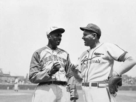 Satchel Paige, left, and Dizzy Dean, pitchers at an exhibition game at Wrigley Field in Chicago compare grips before a game in 1947.  (Photo by Mark Rucker/Transcendental Graphics/Getty Images) Photo: Transcendental Graphics, Getty Images