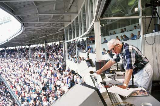 "A General view of Wrigley Field Stadium as Harry Caray sings ""Take me out the ball game"" during the seven inning stretch in Chicago, Illinois. (Photo by John Soohoo/MLB Photos via Getty Images) Photo: Jon SooHoo, MLB Photos Via Getty Images"