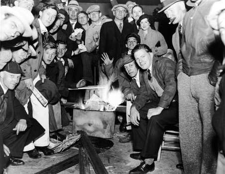 View of baseball fans as they keep warm in front of a fire while they wait outside Wrigley Field the night before tickets go on sale for the World Series between their hometown Chicago Cubs and the Detroit Tigers, September 30, 1935. The Tigers went on to win the series by four games to two. (Photo by FPG/Getty Images) Photo: FPG, Getty Images