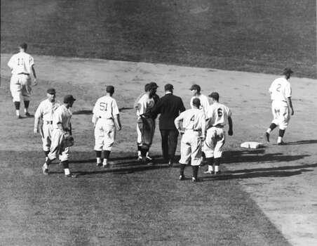 Members of the Chicago Cubs baseball team protest umpire George Moriarty (1884 - 1964) (center, in black) and his decisiion to call Phil Cavarretta out after an attempted steal second base during the 6th inning of the third game of the World Series against the Detroit Tigers at Wrigley Field, October 4, 1935. Other visible players are, from left, the Cubs' Billy Jurges (1908 - 1997) (#11), unidentified, Cavarretta, Augie Galan (1912 - 1993) (#51), unidentified, and manager Charlie Grimm (1898 - 1983) (in grey shirt, mostly obscured), Moriarty, the Tigers' pitcher Goose Goslin (1901 - 1971) (#4), and the Cubs' Frank Demaree (1910 - 1958) (#6), and Billy Herman (1909 - 1992) (#2). The Tigers went on to win the series by four games to two. (Photo by FPG/Getty Images) Photo: FPG, Getty Images