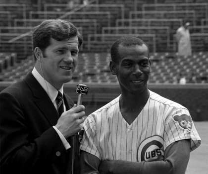 Broadcaster Tony Kubek from NBC interviews firstbaseman Ernie Banks #14 of the Chicago Cubs prior to a  game in 1969 at Wrigley Field in Chicago Illinois. (Photo by: Diamond Images/Getty Images) Photo: Diamond Images, Diamond Images/Getty Images