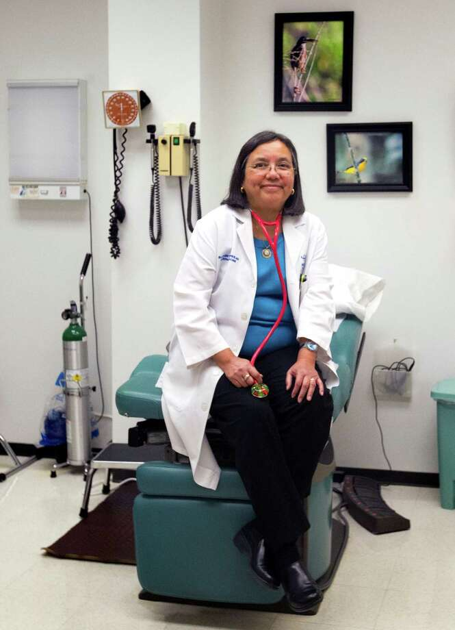 Dr. Elizabeth Torres, president of the Harris County Medical Society, says Medicaid pays far less than private insurers pay. Photo: Cody Duty, Staff / © 2014 Houston Chronicle