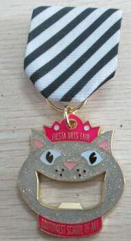 Sorry! The Southwest School of Art's pretty kitty/bottle opener medal is sold out. Better luck next year. Courtesy photo.