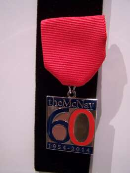 This year the McNay's Fiesta medal marks the museum's big 6-0. $6 at the museum store. Courtesy photo.