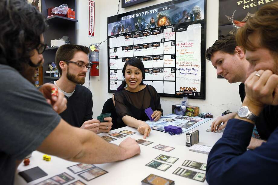 Mike Escalante (left), Elliot Morrow, Andi Morrow, Scott Goodenow and Stewart McMaken play Magic: The Gathering. Photo: Carlos Avila Gonzalez, The Chronicle