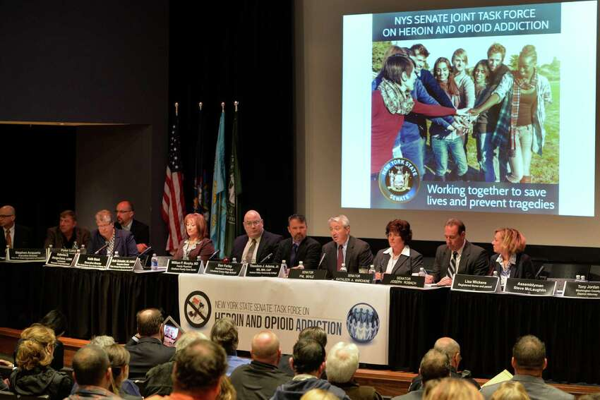 Senator Kathleen Marchione, center, leads panel discussion on abuse of heroin and opioids this morning April 23, 2014 at Hudson Valley Community College in Troy, N.Y. (Skip Dickstein / Times Union)