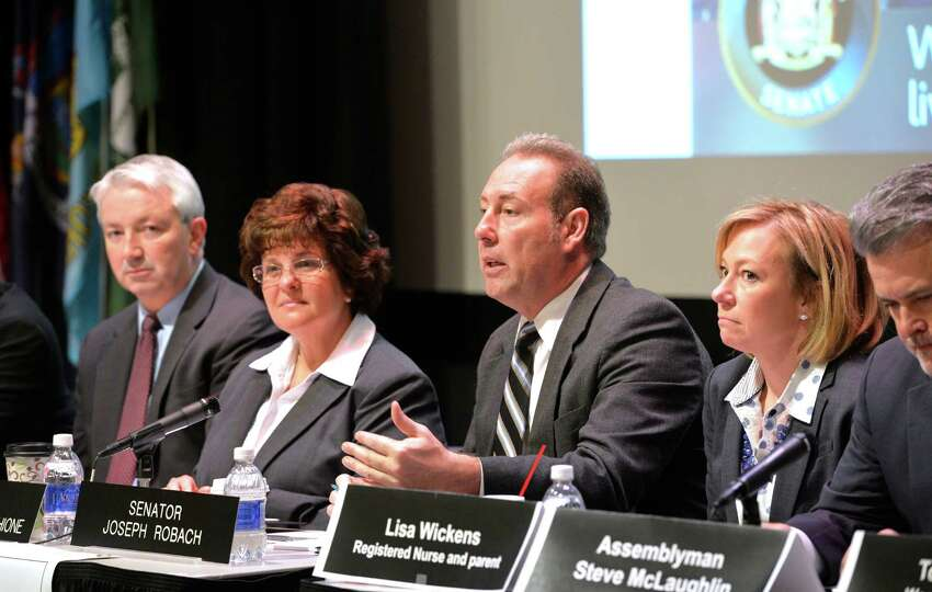 Senator Joseph Robach, second from right speaks during a panel discussion on abuse of heroin and opioids this morning April 23, 2014 at Hudson Valley Community College in Troy, N.Y. (Skip Dickstein / Times Union)