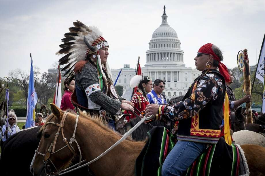 Keystone opponents protest the pipeline across the country. Members of the Cowboy and Indian Alliance (CIA), a group of ranchers, farmers and indigenous leaders, ride horses past the U.S. Capitol during a protest against the Keystone XL pipeline on the National Mall in Washington, D.C., U.S., on Tuesday, April 22, 2014. TransCanada Corp. is awaiting a U.S. permit to build the northern leg of Keystone XL, which would supply U.S. Gulf Coast refineries with crude from Alberta's oil sands. Because it crosses an international boundary, the proposal requires State Department approval. Photographer: Pete Marovich/Bloomberg Photo: Pete Marovich, Bloomberg