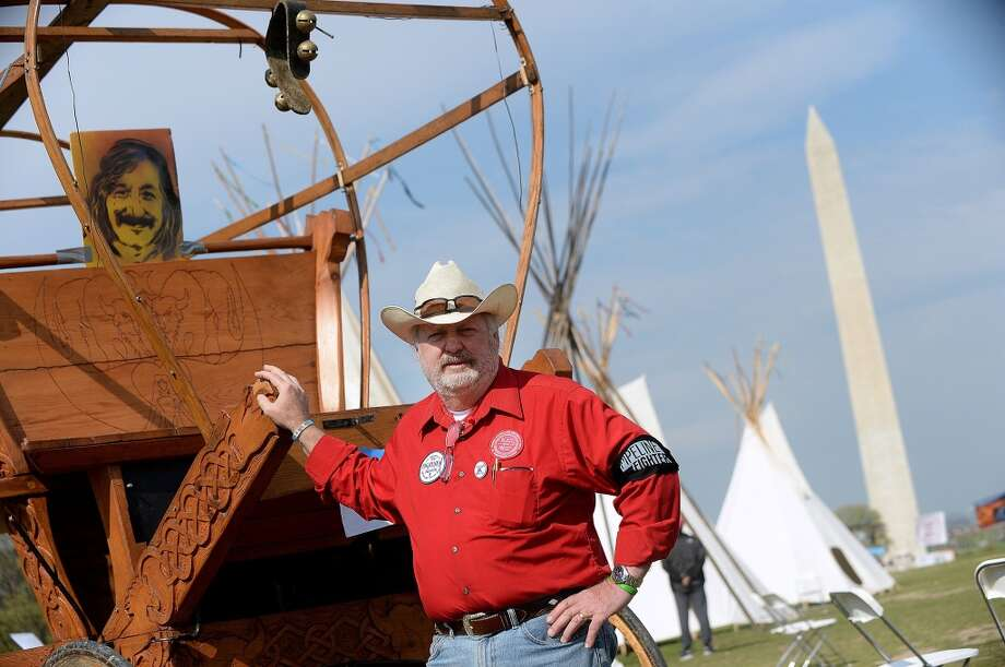 Tom Genung from Nebraska, and a member of the Cowboy and Indian Alliance sets up camp on the Mall in Washington, D.C. as a protest of the proposed construction of the Keystone XL pipeline, April 22, 2014. (Olivier Douliery/Abaca Press/MCT) Photo: Olivier Douliery, McClatchy-Tribune News Service