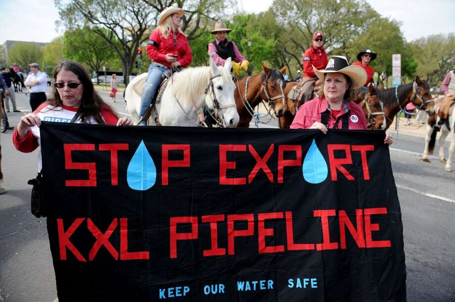 A coalition of Native American groups and cattle ranchers -- the Cowboy and Indian Alliance -- take a horseback ride around the Mall in Washington, D.C. as a protest of the proposed construction of the Keystone XL pipeline, April 22, 2014. (Olivier Douliery/Abaca Press/MCT) Photo: Olivier Douliery, McClatchy-Tribune News Service