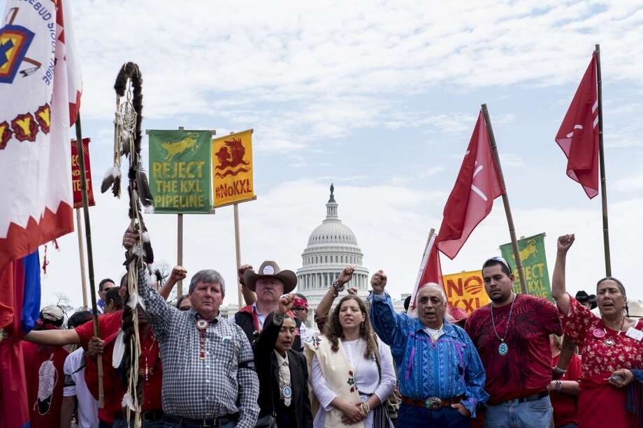 Members of the Cowboy and Indian Alliance (CIA), a group of ranchers, farmers and indigenous leaders, march outside the U.S. Capitol during a protest against the Keystone XL pipeline on the National Mall in Washington, D.C., U.S., on Tuesday, April 22, 2014. TransCanada Corp. is awaiting a U.S. permit to build the northern leg of Keystone XL, which would supply U.S. Gulf Coast refineries with crude from Alberta's oil sands. Because it crosses an international boundary, the proposal requires State Department approval. Photographer: Pete Marovich/Bloomberg Photo: Pete Marovich, Bloomberg
