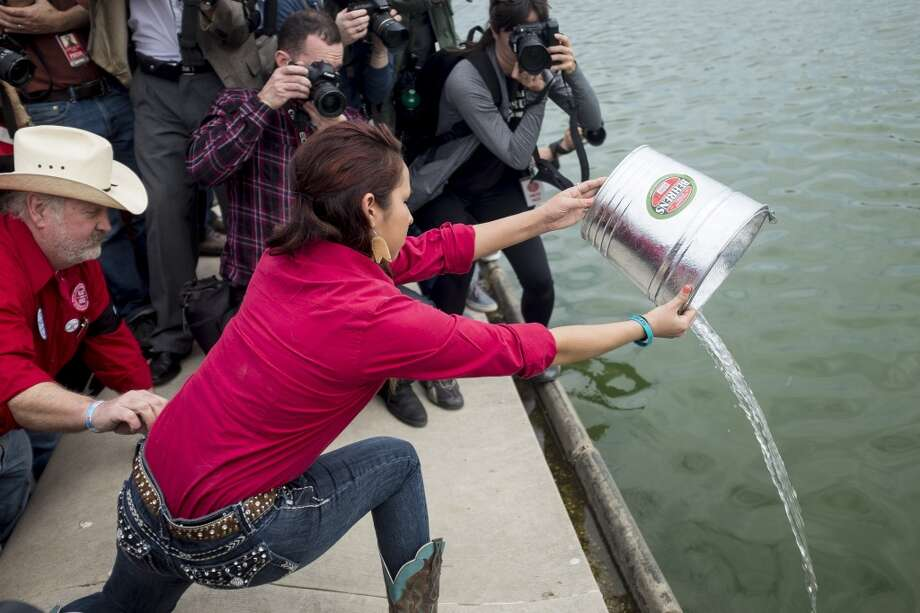 Gianna Strong, 19, of the Sisseton-Wahpeton Tribe in Morton, Minnesota, pours water into the Reflecting Pool in front of the U.S. Capitol during a traditional water ceremony, as part of a protest against the Keystone XL pipeline on the National Mall in Washington, D.C., U.S., on Tuesday, April 22, 2014. TransCanada Corp. is awaiting a U.S. permit to build the northern leg of Keystone XL, which would supply U.S. Gulf Coast refineries with crude from Alberta's oil sands. Because it crosses an international boundary, the proposal requires State Department approval. Photographer: Pete Marovich/Bloomberg *** Local Caption *** Gianna Strong Photo: Pete Marovich, Bloomberg