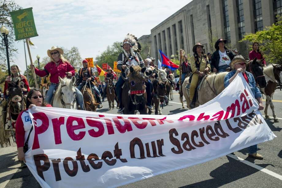 Members of the Cowboy and Indian Alliance (CIA), a group of ranchers, farmers and indigenous leaders, march during a protest against the Keystone XL pipeline in Washington, D.C., U.S., on Tuesday, April 22, 2014. TransCanada Corp. is awaiting a U.S. permit to build the northern leg of Keystone XL, which would supply U.S. Gulf Coast refineries with crude from Alberta's oil sands. Because it crosses an international boundary, the proposal requires State Department approval. Photographer: Pete Marovich/Bloomberg Photo: Pete Marovich, Bloomberg
