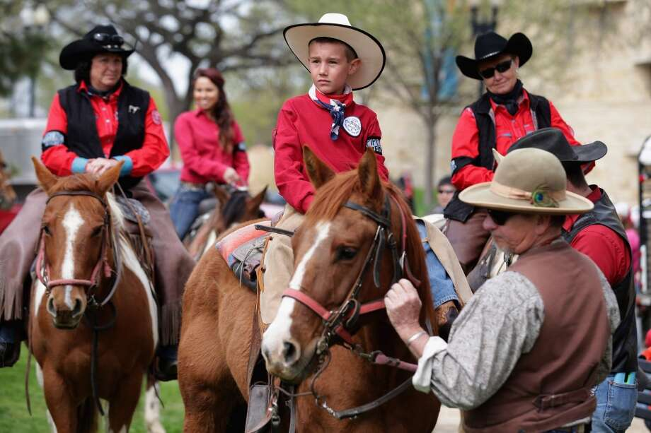 """WASHINGTON, DC - APRIL 22:  Members of the Cowboy and Indian Alliance, including Native Americans, farmers and ranchers from across the United States, prepare for a horseback ride as part of a demonstration against the proposed Keystone XL pipeline April 22, 2014 in Washington, DC. As part of its """"Reject and Protect"""" protest, the Cowboy and Indian Alliance is organizing a weeklong series of actions by farmers, ranchers and tribes to show their opposition to the pipeline.  (Photo by Chip Somodevilla/Getty Images) Photo: Chip Somodevilla, Getty Images"""