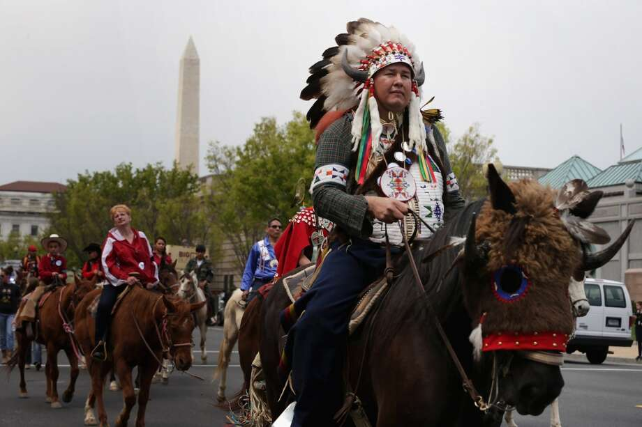 "WASHINGTON, DC - APRIL 22:  Shane Red Hawk of the Sicangu Lakota Band of the Rosebud Sioux Tribe from Rosebud, South Dakota, joins other members of the Cowboy and Indian Alliance for a horseback ride on Independence Avenue while demonstrating against the proposed Keystone XL pipeline April 22, 2014 in Washington, DC. As part of its ""Reject and Protect"" protest, the Cowboy and Indian Alliance is organizing a weeklong series of actions by farmers, ranchers and tribes to show their opposition to the pipeline.  (Photo by Chip Somodevilla/Getty Images) Photo: Chip Somodevilla, Getty Images"