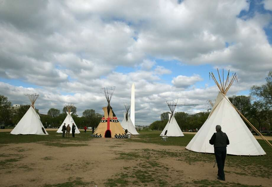 WASHINGTON, DC - APRIL 23:  Bryan Brewer (R), president of the Oglala Sioux Tribe of South Dakota walks up to Indian teepees that are on the National Mall as part of a protest against the Keystone pipeline, April 23, 2014 in Washington, DC. As part of its 'Reject and Protect' protest, the Cowboy and Indian Alliance is organizing a weeklong series of actions by farmers, ranchers and tribes to show their opposition to the pipeline.  (Photo by Mark Wilson/Getty Images) Photo: Mark Wilson, Getty Images