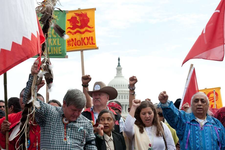 "Native Americans, farmers and ranchers hold a ceremony in front of the US Capitol in Washington on April 22, 2014 as the Cowboy and Indian Alliance protest the proposed Keystone XL pipeline, part of ""Reject and Protect,"" a weeklong series of actions by farmers, ranchers and tribes against the tar sands oil pipeline from Canada to the US.   AFP PHOTO/Nicholas KAMMNICHOLAS KAMM/AFP/Getty Images Photo: NICHOLAS KAMM, AFP/Getty Images"