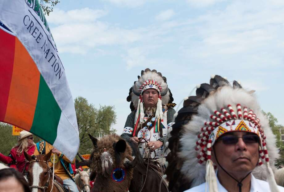 "Members of the Cowboy and Indian Alliance march in Washington on April 22, 2014 as they protest the proposed Keystone XL pipeline, part of ""Reject and Protect,"" a weeklong series of actions by farmers, ranchers and tribes against the tar sands oil pipeline from Canada to the US.   AFP PHOTO/Nicholas KAMMNICHOLAS KAMM/AFP/Getty Images Photo: NICHOLAS KAMM, AFP/Getty Images"