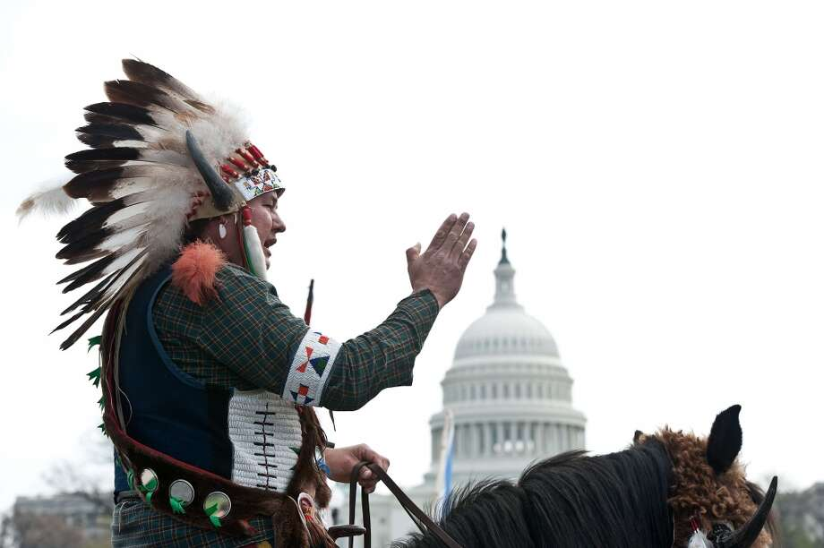 "TOPSHOTS A Native American tribal leader sits on his horse in front of the US Capitol in Washington on April 22, 2014 as the Cowboy and Indian Alliance protest the proposed Keystone XL pipeline, part of ""Reject and Protect,"" a weeklong series of actions by farmers, ranchers and tribes against the tar sands oil pipeline from Canada to the US.   AFP PHOTO/Nicholas KAMMNICHOLAS KAMM/AFP/Getty Images Photo: NICHOLAS KAMM, AFP/Getty Images"