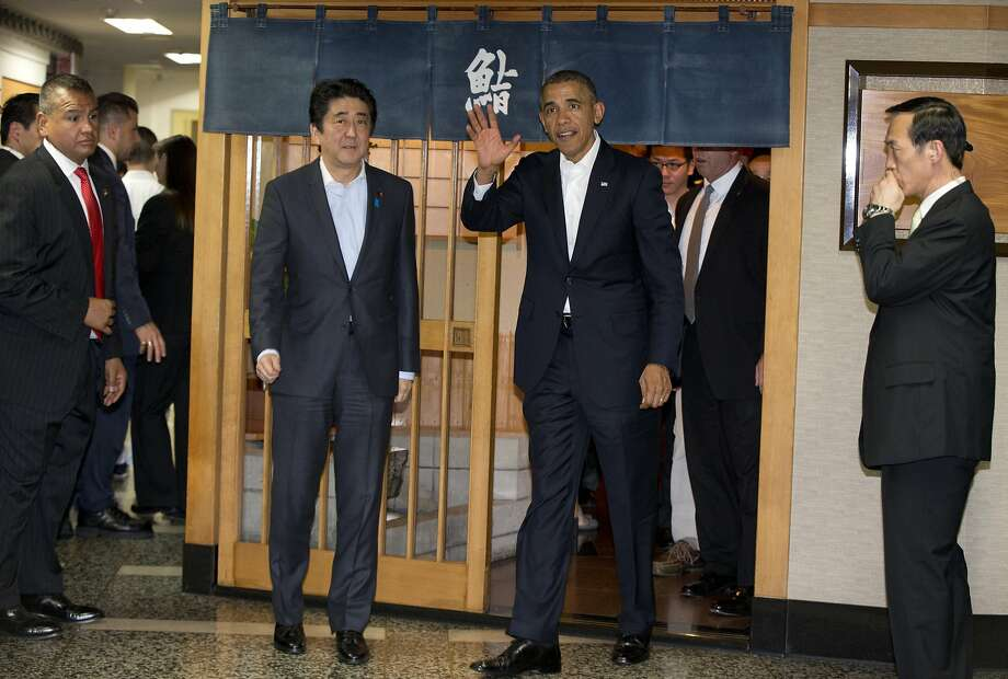 President Obama and Japanese Prime Minister Shinzo Abe leave after eating at a sushi restaurant in Tokyo. The dinner opened a week of delicate diplomacy in four Asian countries. Photo: Carolyn Kaster, Associated Press