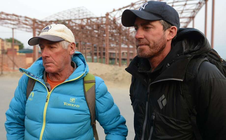 New Zealand mountaineer and Mount Everest expedition organiser Russell Brice (L) and British mountaineer and expedition leader Phil Crampton (R) talk with AFP, after flying from Mount Everest Base Camp to Kathmandu to speak with members of the Nepalese Government, at Kathmandu Airport on April 22, 2014. Nepalese guides on Mount Everest said they had decided to abandon this year's climbing season to honour 16 colleagues killed in an avalanche. The decision throws the plans of hundreds of foreign mountaineers into chaos, with many of them waiting in base camp after paying tens of thousands of dollars to scale the world's highest peak. The guides had threatened to cancel all climbing on Mount Everest and issued an ultimatum to the government, demanding higher compensation, an agreement to revise insurance payments and a welfare fund. The decision to abandon the season appeared to pre-empt the outcome of talks underway in Kathmandu. High-profile Western mountaineers headed to the capital to seek a resolution to the crisis.  AFP PHOTO / Prakash MATHEMAPRAKASH MATHEMA/AFP/Getty Images Photo: Prakash Mathema, AFP/Getty Images